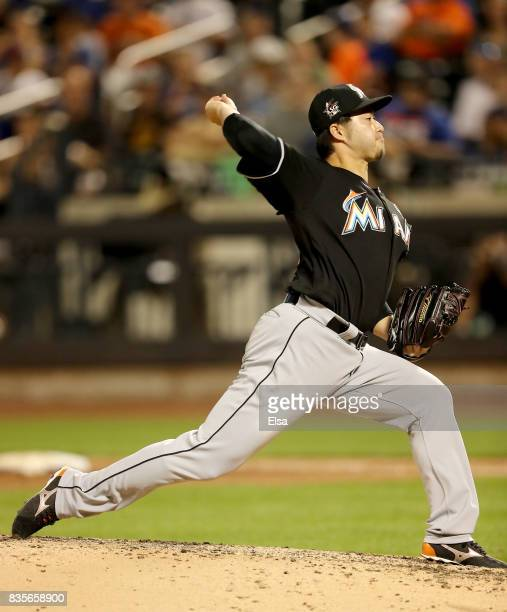 Junichi Tazawa of the Miami Marlins delivers a pitch in the sixth inning against the New York Mets on August 19 2017 at Citi Field in the Flushing...