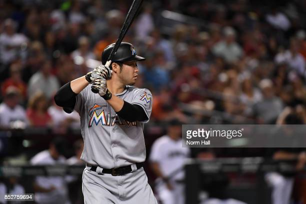 Junichi Tazawa of the Miami Marlins gets ready in the batters box against the Arizona Diamondbacks at Chase Field on September 22 2017 in Phoenix...