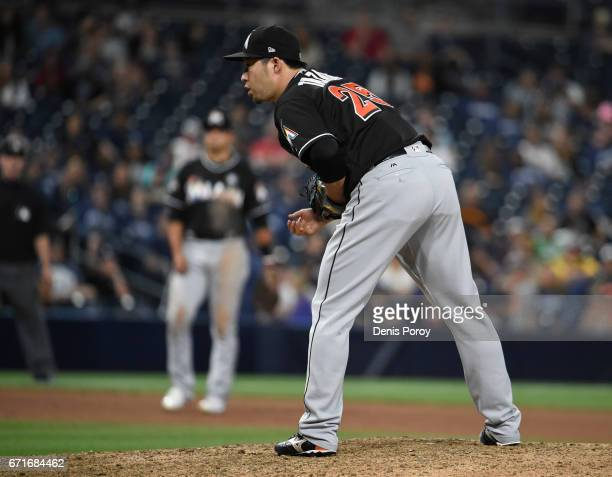 Junichi Tazawa of the Miami Marlins gets ready to pitch during the eleventh inning of a baseball game against the San Diego Padres at PETCO Park on...