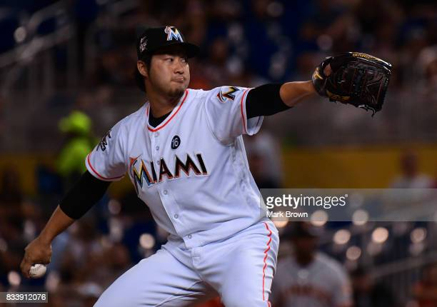 Junichi Tazawa of the Miami Marlins in action during the game between the Miami Marlins and the San Francisco Giants at Marlins Park on August 15...