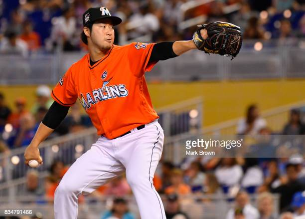 Junichi Tazawa of the Miami Marlins in action during the game between the Miami Marlins and the Colorado Rockies at Marlins Park on August 13 2017 in...