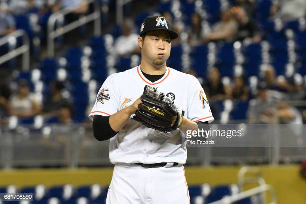 Junichi Tazawa of the Miami Marlins in between pitches during the seventh inning against the St Louis Cardinals at Marlins Park on May 10 2017 in...