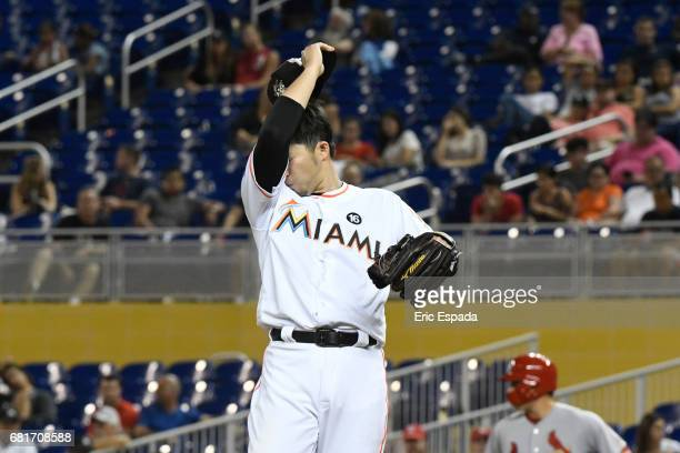 Junichi Tazawa of the Miami Marlins inbetween pitches during the seventh inning against the St Louis Cardinals at Marlins Park on May 10 2017 in...