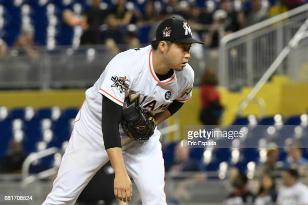 Junichi Tazawa of the Miami Marlins looks into home plate during the seventh inning against the St Louis Cardinals at Marlins Park on May 10 2017 in...