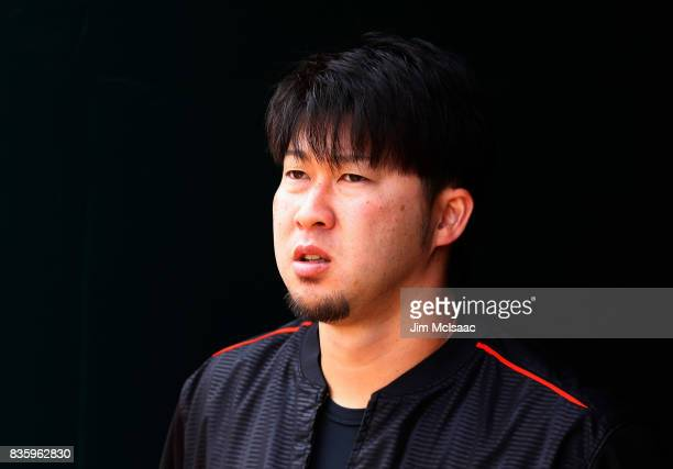 Junichi Tazawa of the Miami Marlins looks on before the start of a game against the New York Mets at Citi Field on August 20 2017 in the Flushing...