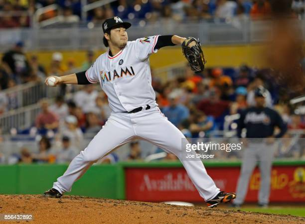 Junichi Tazawa of the Miami Marlins pitches against the Atlanta Braves in the seventh inning at Marlins Park on October 1 2017 in Miami Florida