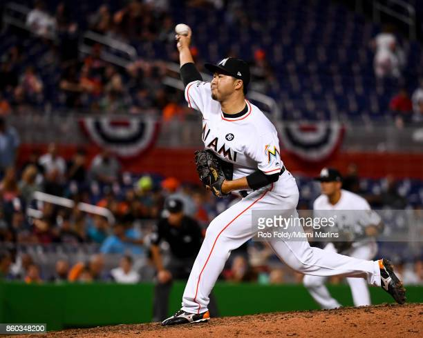 Junichi Tazawa of the Miami Marlins pitches during the game against the Atlanta Braves at Marlins Park on April 12 2017 in Miami Florida