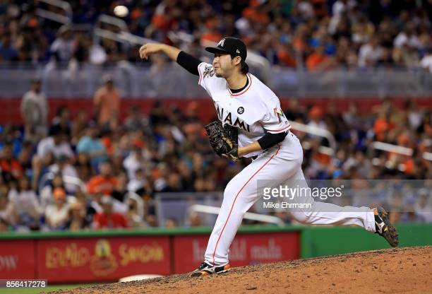 Junichi Tazawa of the Miami Marlins pitches in the seventh inning during a game against the Atlanta Braves at Marlins Park on October 1 2017 in Miami...