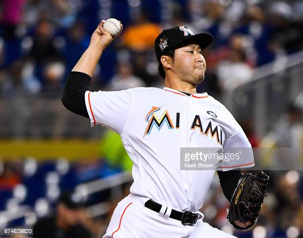 Junichi Tazawa of the Miami Marlins pitches in the seventh inning during the game between the Miami Marlins and the Pittsburgh Pirates at Marlins...