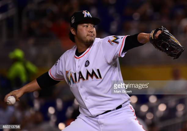 Junichi Tazawa of the Miami Marlins pitches in the seventh inning during the game between the Miami Marlins and the San Francisco Giants at Marlins...