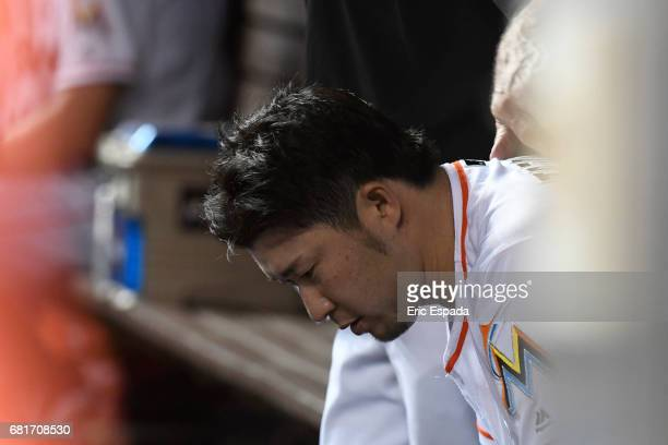 Junichi Tazawa of the Miami Marlins sits in the dugout dejected after pitching the seventh inning against the St Louis Cardinals at Marlins Park on...