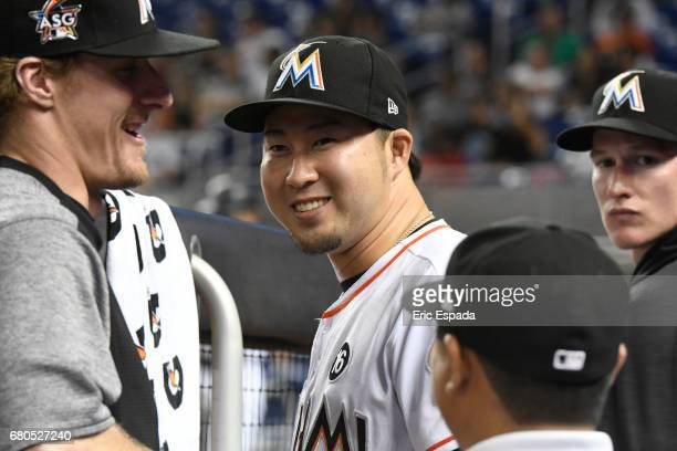Junichi Tazawa of the Miami Marlins smiles in the dugout after pitching the eighth inning against the St Louis Cardinals at Marlins Park on May 8...