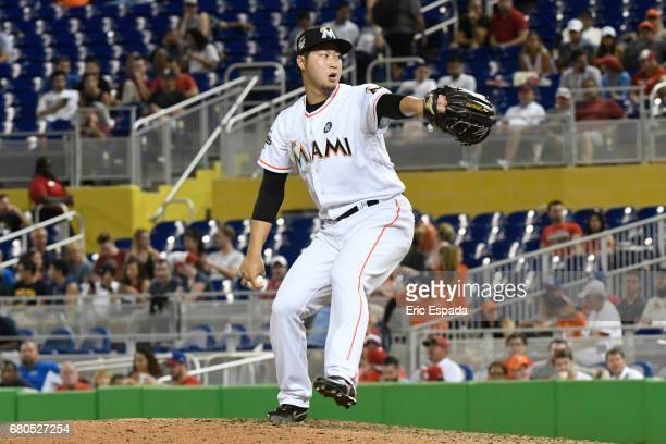 Junichi Tazawa of the Miami Marlins throws a pitch during the eighth inning against the St Louis Cardinals at Marlins Park on May 8 2017 in Miami...