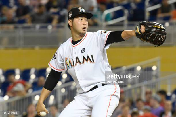 Junichi Tazawa of the Miami Marlins throws a pitch during the seventh inning against the St Louis Cardinals at Marlins Park on May 10 2017 in Miami...