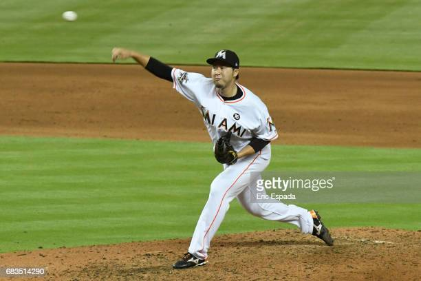 Junichi Tazawa of the Miami Marlins throws a pitch during the sixth inning against the Houston Astros at Marlins Park on May 15 2017 in Miami Florida