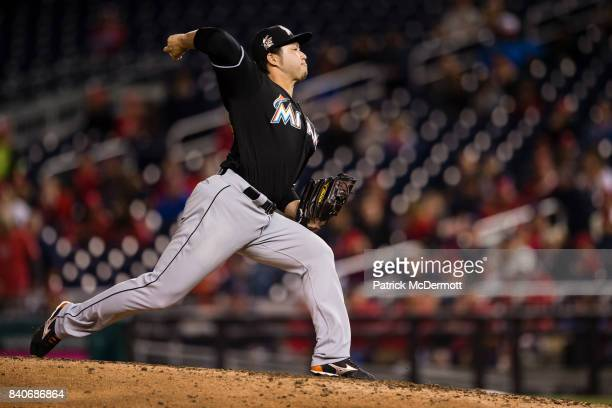 Junichi Tazawa of the Miami Marlins throws a pitch to a Washington Nationals batter in the seventh inning at Nationals Park on August 29 2017 in...