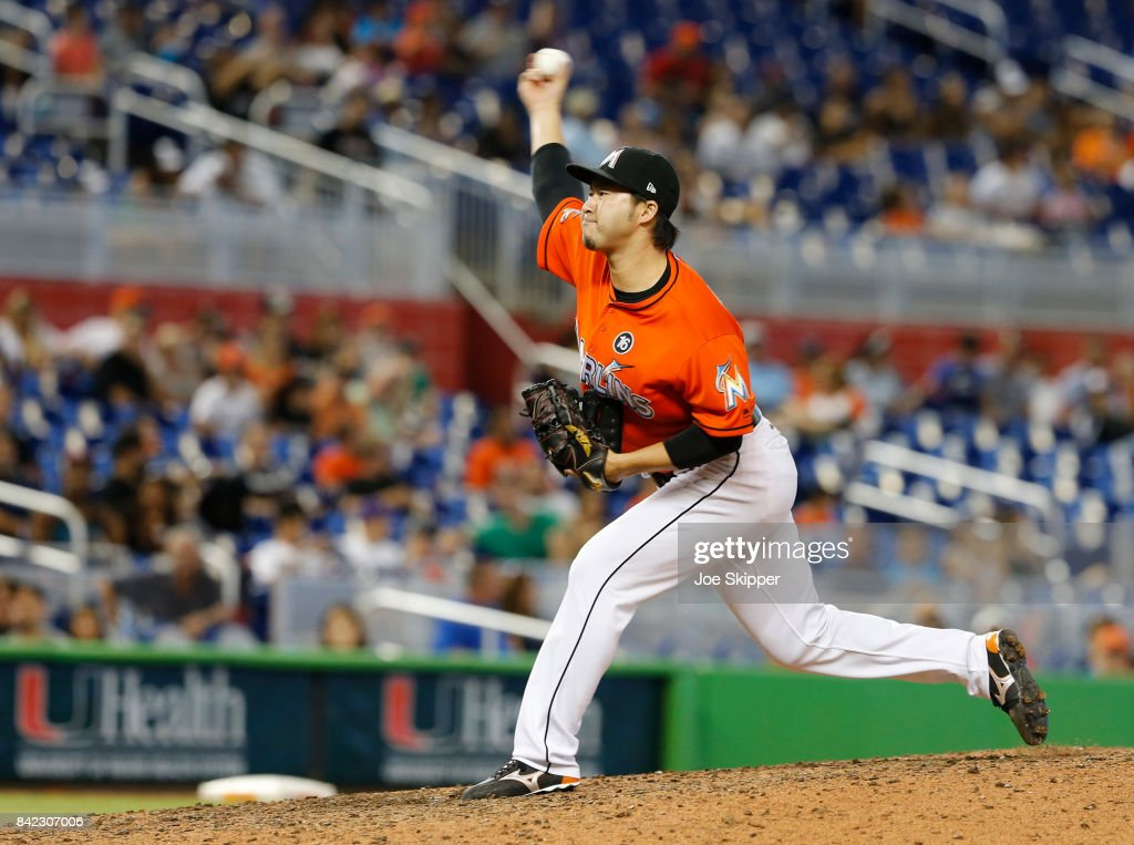 Junichi Tazawa #25 of the Miami Marlins throws against the Philadelphia Phillies in the 12th inning at Marlins Park on September 3, 2017 in Miami, Florida.