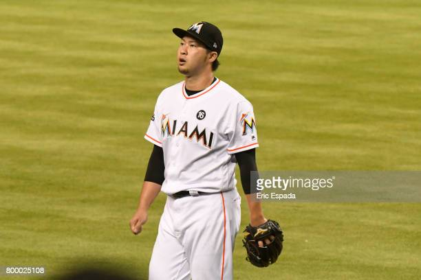 Junichi Tazawa of the Miami Marlins walks balk tot he dugout after pitching the sixth inning against the Chicago Cubs at Marlins Park on June 22 2017...