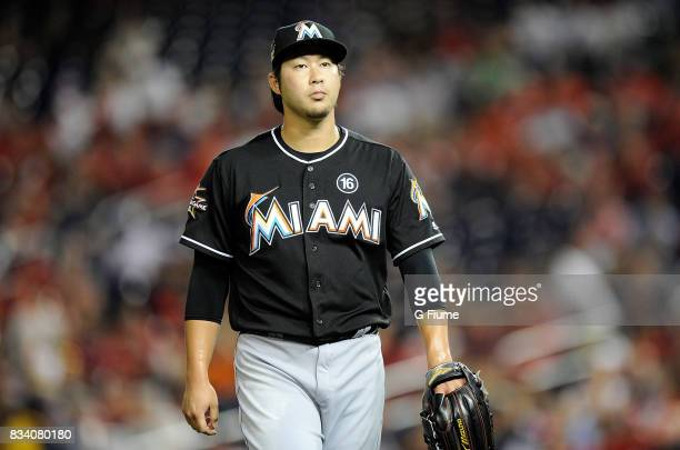Junichi Tazawa of the Miami Marlins walks to the dugout after the end of the eighth inning against the Washington Nationals at Nationals Park on...