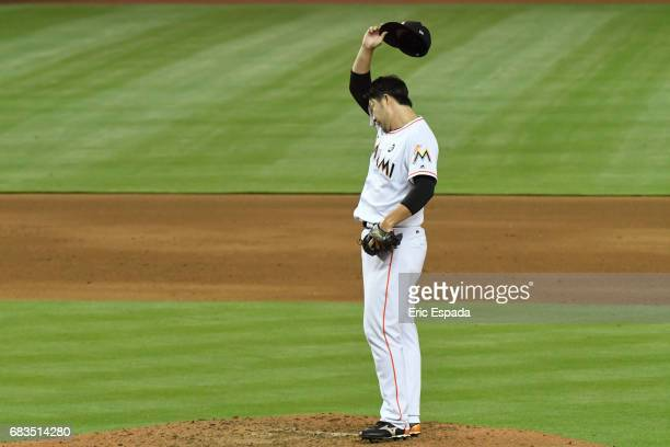 Junichi Tazawa of the Miami Marlins wipes his forehead during the sixth inning against the Houston Astros at Marlins Park on May 15 2017 in Miami...