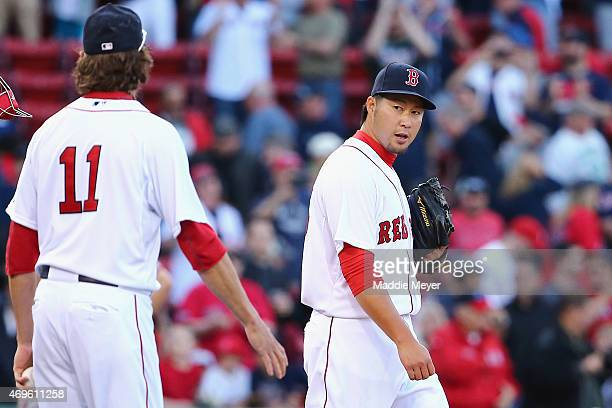 Junichi Tazawa talks with Clay Buchholz of the Boston Red Sox at the end of the ninth inning at Fenway Park on April 13 2015 in Boston Massachusetts...