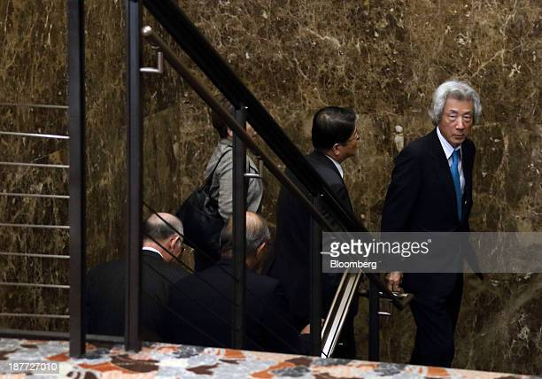 Junichiro Koizumi former Japan prime minister right arrives for a news conference at the Japan National Press Club in Tokyo Japan on Tuesday Nov 12...