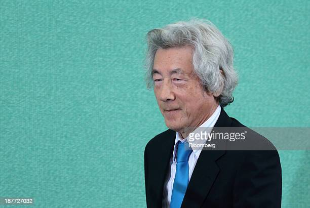 Junichiro Koizumi former Japan prime minister walks to the podium during a news conference at the Japan National Press Club in Tokyo Japan on Tuesday...