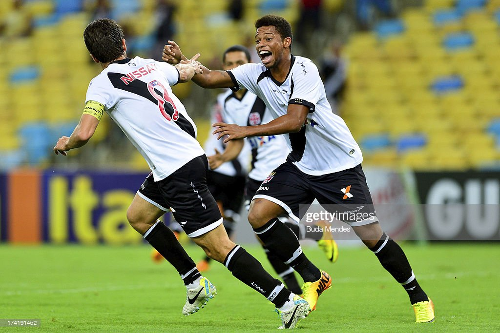 Juninho (L) and his teammates of Vasco celebrate a goal against Fluminense during a match between Fluminense and Vasco as part of Brazilian Championship 2013 at Maracana Stadium on July 21, 2013 in Rio de Janeiro, Brazil.