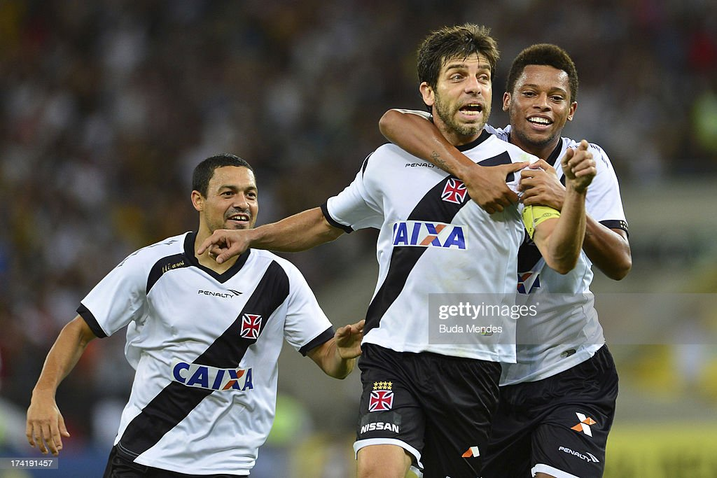 Juninho (C) and his teammates of Vasco celebrate a goal against Fluminense during a match between Fluminense and Vasco as part of Brazilian Championship 2013 at Maracana Stadium on July 21, 2013 in Rio de Janeiro, Brazil.