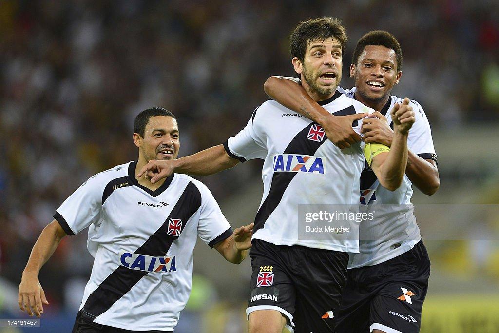 Juninho (C) and his teammates of Vasco celebrate a goal against Fluminense during a match between Fluminense and Vasco as part of Brazilian Championship 2013 at Maracana Stadium on July 21, 2013 in Rio de Janeiro, Brazil.