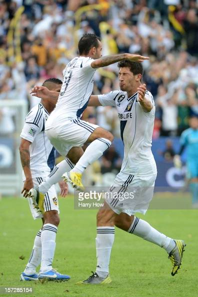 Juninho and Omar Gonzalez of Los Angeles Galaxy celebrate after Gonzalez scores in the second half against the Houston Dynamo in the 2012 MLS Cup at...