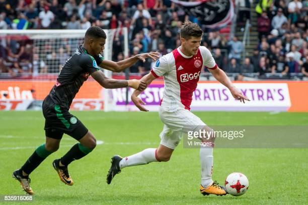 Juninho Bacuna of FC Groningen Klaas Jan Huntelaar of Ajax during the Dutch Eredivisie match between Ajax Amsterdam and FC Groningen at the Amsterdam...