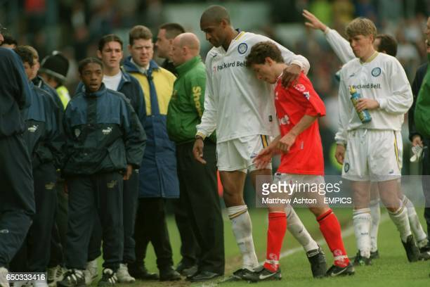 Juninho crys on the shoulder of Leeds' Brian Deane after Middlesbrough were relegated at Elland Road