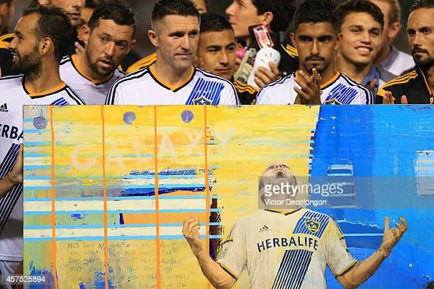 Juninho Dan Gargan Robbie Keane Jose Villareal AJ DeLaGarza Oscar Sorto and Marcelo Sarvas of the Los Angeles Galaxy stand behind a piece of artwork...