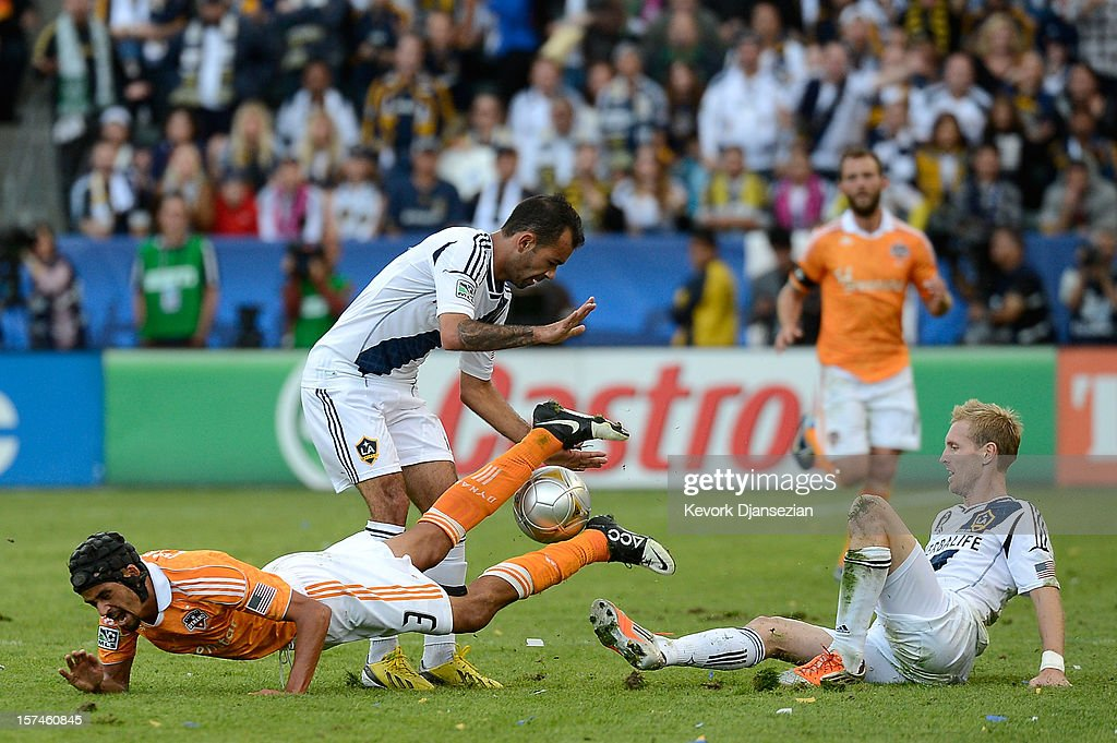 Juninho of Los Angeles Galaxy goes for the ball against Calen Carr of Houston Dynamo in the 2012 MLS Cup at The Home Depot Center on December 1 2012...