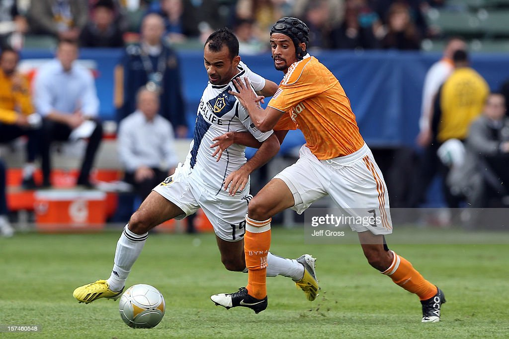 Juninho of Los Angeles Galaxy moves the ball against Calen Carr of Houston Dynamo in the 2012 MLS Cup at The Home Depot Center on December 1 2012 in...