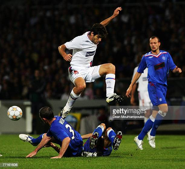 Juninho of Lyon jumps the tackle from David Wier of Rangers during the UEFA Champions League match between Lyon and Glasgow Rangers at Gerland...
