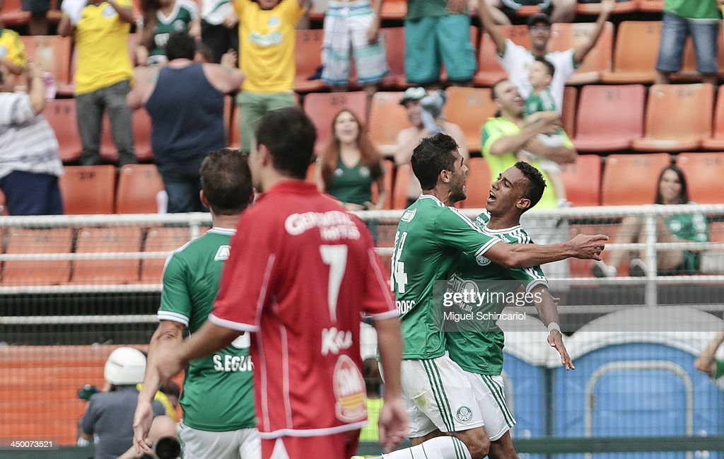 Juninho (R) of Palmeiras celebrate a goal during the match between Palmeiras and Boa Esporte for the Brazilian Championship Series B 2013 at Pacaembu Stadium on November 16, 2013 in Sao Paulo, Brazil.