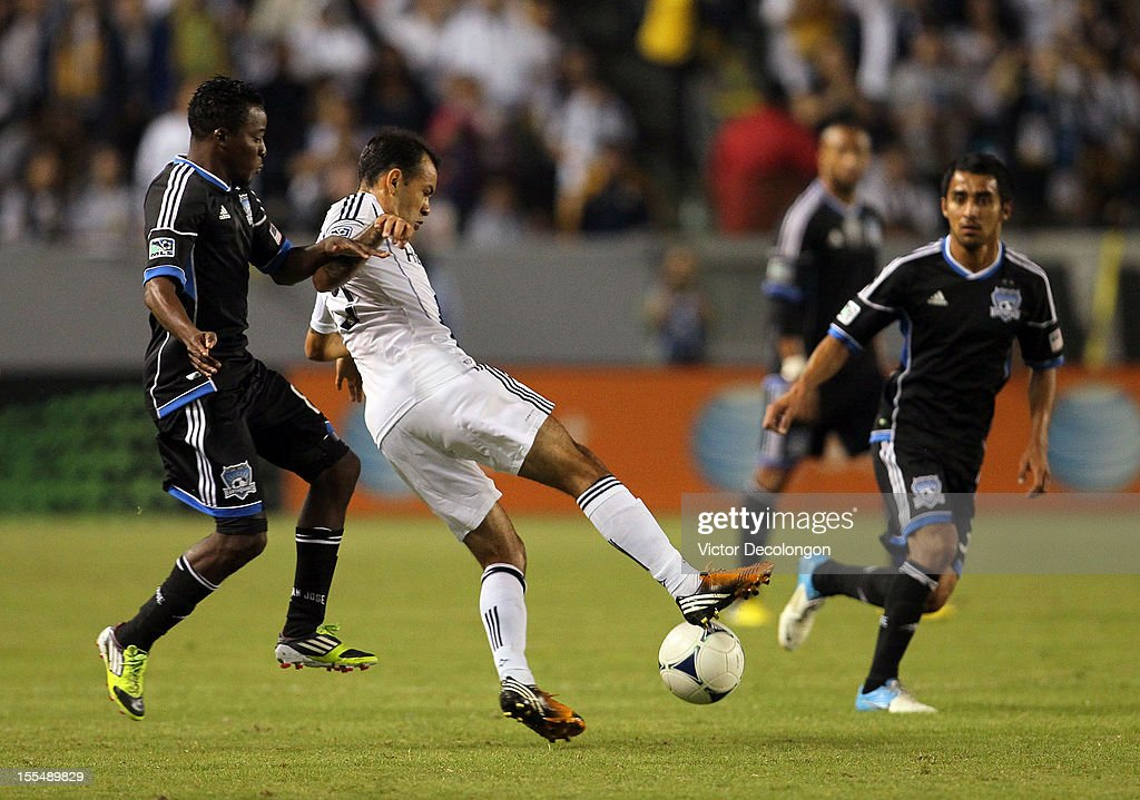 <a gi-track='captionPersonalityLinkClicked' href=/galleries/search?phrase=Juninho&family=editorial&specificpeople=167167 ng-click='$event.stopPropagation()'>Juninho</a> #19 of the Los Angeles Galaxy and Marvin Chavez #81 of the San Jose Earthquakes vie for the ball in the first half during the first leg of the MLS Western Conference Semifinal match at The Home Depot Center on November 4, 2012 in Carson, California. The Earthquakes defeated the Galaxy 1-0.