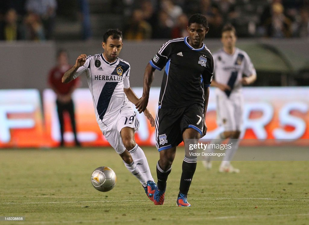 Juninho of the Los Angeles Galaxy pressures Khari Stephenson of the San Jose Earthquakes in the second half of the MLS match at The Home Depot Center...
