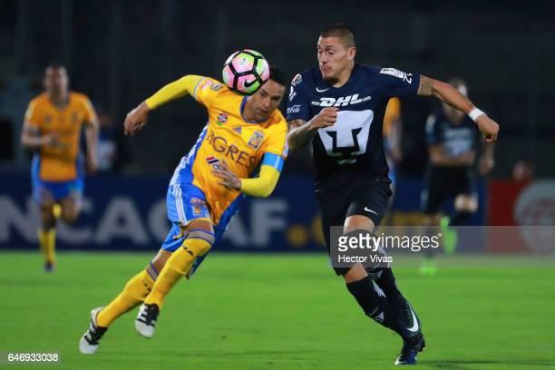 Juninho of Tigres struggles for the ball with Nicolas Castillo of Pumas during the quarterfinals second leg match between Pumas UNAM and Tigres UANL...