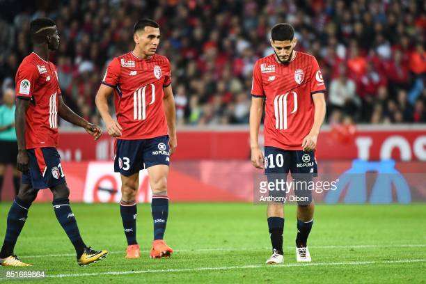 Junior Alonso and Yassine Benzia of Lille looks dejected during the Ligue 1 match between Lille OSC and AS Monaco at Stade Pierre Mauroy on September...