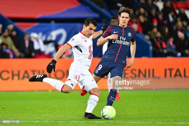Junior Alonso of Lille and Edinson Cavani of PSG during the Ligue 1 match between Paris Saint Germain and Lille OSC at Parc des Princes on December 9...