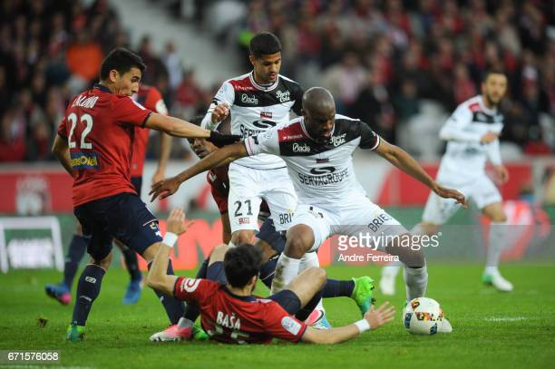 Junior Alonso of Lille and Sloan Privat of Guingamp and Ludovic Blas of Guingamp and Marko Basa of Lille during the Ligue 1 match between Lille OSC...