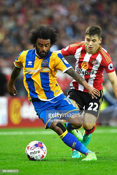 Junior Brown of Shrewsbury Town is closed down by Donald Love of Sunderland during the EFL Cup second round match between Sunderland and Shrewsbury...