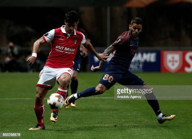 Junior Caicara of Medipol Basaksehir in action against Joao Teixeira of Sporting Braga during the UEFA Europa League Group C match between Sporting...
