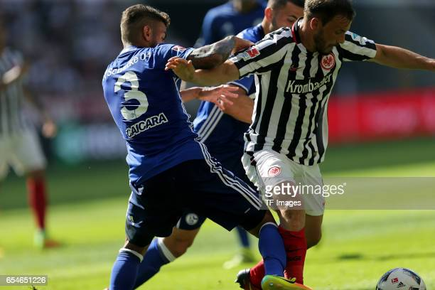 Junior Caicara of Schalke and Szabolcs Huszti of Frankfurt Sead Kolainac of Schalke battle for the ball during the Bundesliga match between Eintracht...