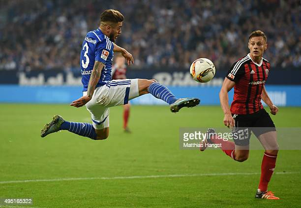Junior Caicara of Schalke plays a pass against Robert Bauer of Ingolstadt during the Bundesliga match between FC Schalke 04 and FC Ingolstadt at...