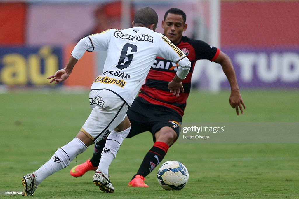 Junior Cesar of Botafogo battles for the ball during the match between Vitoria and Botafogo as part of Brasileirao Series A 2014 at Estadio Manoel Barradas on October 4, 2014 in Salvador, Bahia, Brazil.