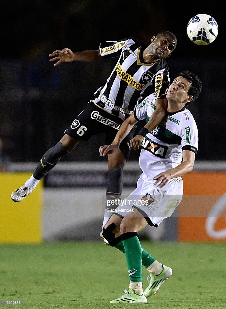 Junior Cesar (L) of Botafogo struggles for the ball with a Felipe of Figueirense during a match between Botafogo and Figueirense as part of Brasileirao Series A 2014 at Sao Januario Stadium on November 19, 2014 in Rio de Janeiro, Brazil.